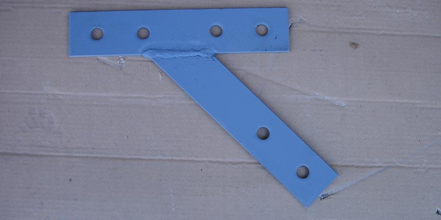 T strap made at a custom angle
